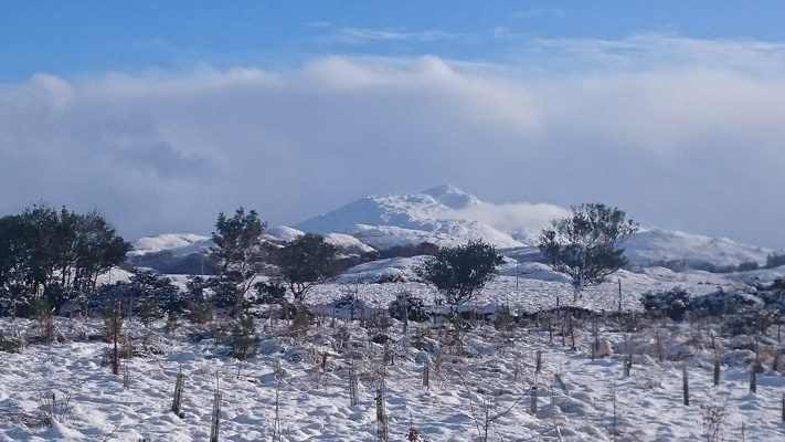 View of Ben Resipole behind caravans in winter, Ardnamurchan Scotland